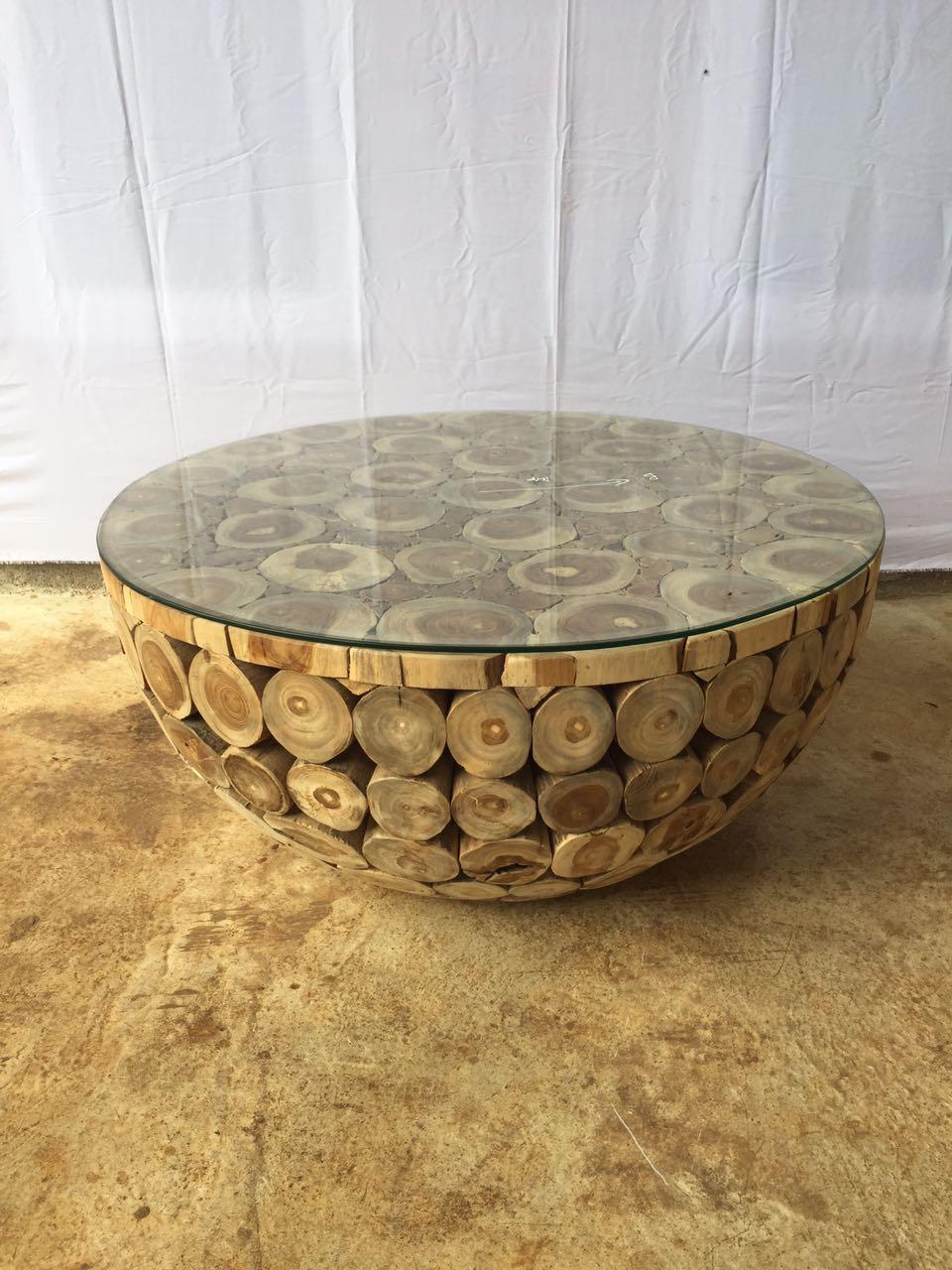 שולחן עגול בולי עץ טיק